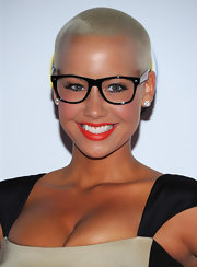 Amber Rose gave her flawless skin a boost with radiant red lipstick.