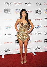 Melanie Iglesias wore a pair of nude peep toe pumps with her shimmering golden dress at the 2011 'Maxim' Hot 100 Party.