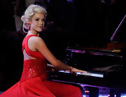 For her talent act, Teresa sat down to the piano in a stunning scarlet gown with classic curly updo.