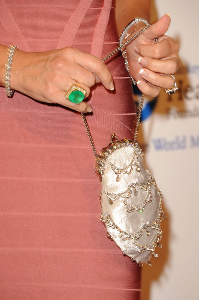 Everything about Linda's look was eye-catching, but this green statement ring really stood out.