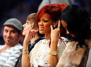 Rihanna sat court side at the All-Star game rockin' a black-and-white moon manicure.