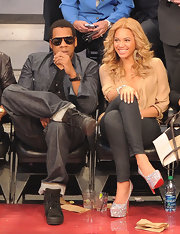 Beyonce wore a glossy metallic silver polish while watching the 2011 NBA All-Star game.