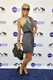 Paris Hilton teamed her flirty striped dress with black suede pumps with gray tonal platforms.