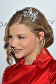 Chloe Moretz wore her lovely locks in a classic bun with feminine face-framing curls and a glitzy diamond-encrusted hair accessory while attending the 2011 National Board of Review Awards Gala.