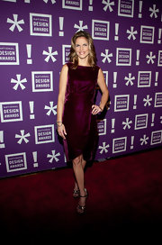 Natalie Morales wore a velvet cranberry faux wrap cocktail dress for the National Design Awards Gala.