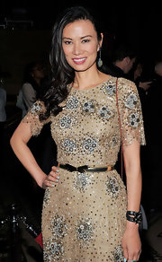 Wendi Deng emphasized her waist by wearing a metallic belt on top of her beaded dress.