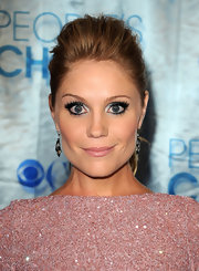 Virgina Williams balanced her soft pink cheeks with shimmering silver shadow. Bold lashes intensified her look.