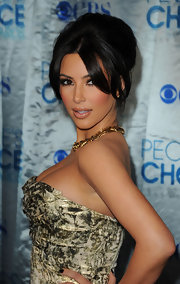 Kim K. was ultra-glam at the People's Choice Awards. She finished off her stunning look with a voluminous French twist complete with face framing bangs.