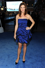 Kate Walsh looked classic in black patent Pigalle pumps.