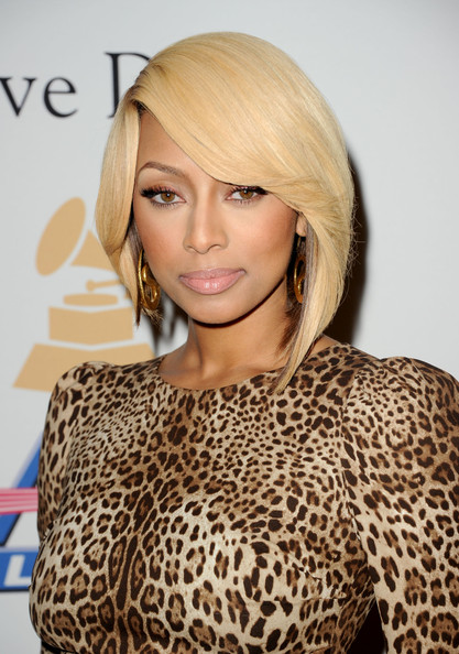 Keri Hilson added a golden touch to her leopard print dress with Snake earrings.