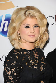Kelly Osbourne showed off voluminous curls at the Grammy gala & salute party.