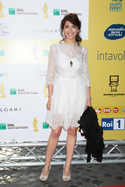 Caterina looked stunning in this white dress with sheer cutout overlay.