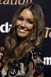 Erin McNaught paired her elegant look with long center part curls.