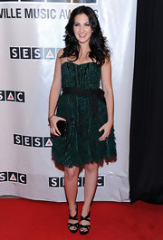 Katie Armiger looked lovely at the Nashville Music Awards in a strapless emerald dress with a bow-adorned waist and feathered hem.