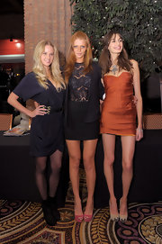Cintia Dicker showed off her best asset - her legs - at the 2011 SI Swimsuit Models event by wearing a black bandeau skirt.