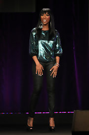 Brandy sparkled in a green iridescent top paired with black leather skinny pants.