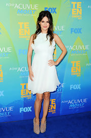 Rachel Bilson gave an edge to her frothy mint dress with a pair of studded taupe suede ankle boots. The Cohen Borchie boots were an unexpectedly fab choice for the Teen Choice Awards.
