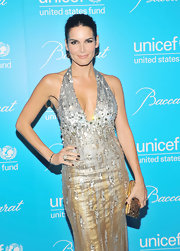 Angie Harmon accessorized her stunning beaded gown with a gilded hard case clutch.