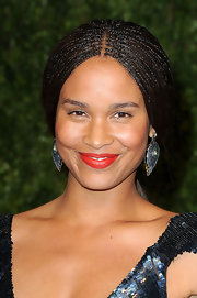 Joy Bryant paired her elegant look with sapphire dangling earrings.