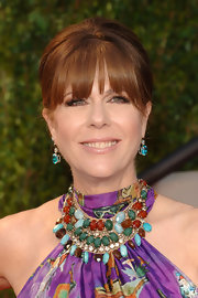Rita Wilson played around with color at the 2011 Vanity Fair Oscar party. She finished off her beaded gown with blue gemstone earrings.