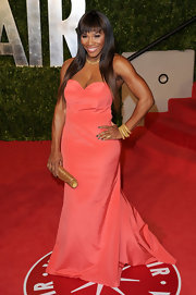 Serena paired her coral strapless gown with an arm full of gold bangle bracelet.