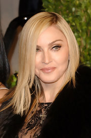 Madonna wore sleek side swept locks to the 2011 Vanity Fair Oscar party.