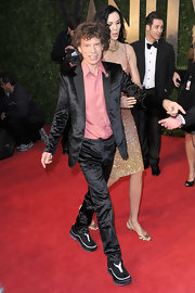 Mick Jagger strutted his stuff on the red carpet in a silky black suit.