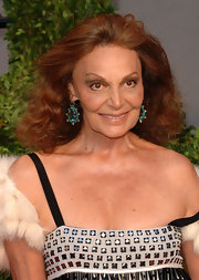 Diane von Furstenberg infused some color into her look with emerald and sapphire gemstone earrings.