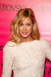 Doutzen Kroes wore her long hair in soft waves at the 2011 Victoria's Secret Fashion Show after party.