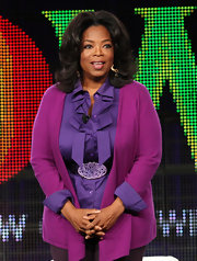 Oprah Winfrey sported a pretty palette with this fuchsia cardigan and purple ruffle blouse combo at the 2011 Winter TCA Tour.