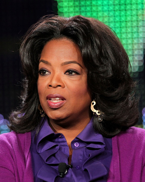 Oprah Winfrey styled her hair in a center-parted feathered flip for the 2011 Winter TCA Tour.