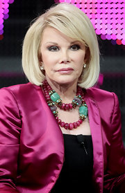 Joan Rivers paired her satin blazer with a matching beaded necklace.