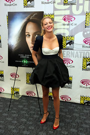 Blake Lively added a pop of color to her flirty WonderCon attire with black and red ankle strap Très Décolleté pumps.
