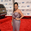 La La Anthony in a slinky sequin jumpsuit