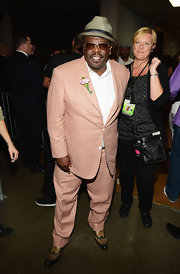 Cedric the Entertainer stood out from the crowd of dark suits in his cheery peach ensemble.