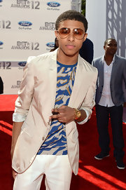 Diggy flashed a bright gold chronograph watch on the red carpet.