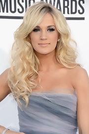Carrie Underwood wore her pale blond hair in long curls for the 2012 Billboard Music Awards.