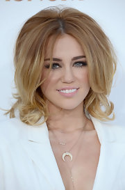 Miley Cyrus wore her hair styled in a voluminous 'do for the 2012 Billboard Music Awards.