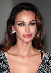 Madalina Ghenea wore a pair of round earrings with diamonds to match her classic outfit at the Convivio event.