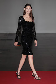 Bianca Balti partnered her gorgeous sequined dress with a black hard case satin clutch at the 2012 Convivio Charity Gala.
