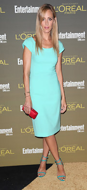 Kim Raver held tight to her petite hard case red clutch at the 2012 Entertainment Weekly Pre-Emmy Party.