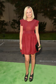 Malin looked darling in her short oxblood dress with a futuristic back and sleeves.