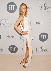 Carolyn Murphy showed some skin in this slinky white beaded dress at the FIT benefit gala.