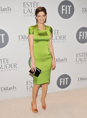 Cindi Leive shined at the FIT benefit gala wearing this lime cocktail dress with gold accessories.