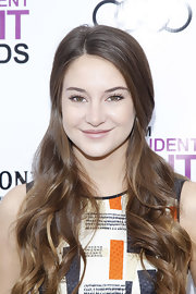 Shailene Woodley attended the 2012 Film Independent Filmmaker Grant and Spirit Awards Nominees Lunch wearing her hair partially pulled back with the longer lengths in loose curls.