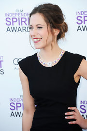 Maria Leon completed her chic LBD look with a loosely styled bun.