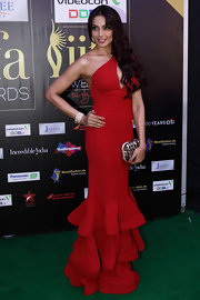 Bipasha Basu oozed ultra-feminine elegance in a red one-shoulder evening dress with a tiered hem during the 2012 IIFA Awards.