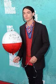 Ezra Miller looked unusually 'normal' as he paired his casual jeans and shirt with a black blazer at the 2012 MTV Movie Awards.
