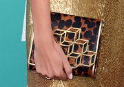 Nikki's leopard clutch was a much needed break from the metallic uniform.