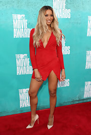 Leave it to Ciara to bring a heavy dose of sex-appeal anywhere she goes. She showed off her body in this deep-V red number with a high hem and even higher slit.